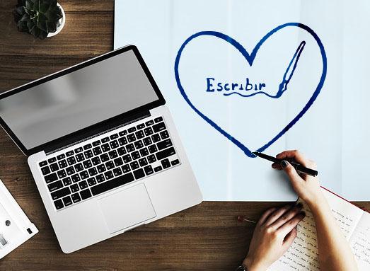 """Escribir es un acto de amor , una mano que escribe dibuja un corazón, dentro la palabra """"escribir"""" y una pluma."""
